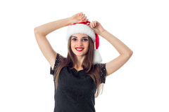 Beauty young girl in santa hat Stock Photography