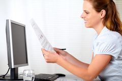 Beauty young girl working at workplace Royalty Free Stock Photography