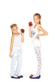 Beauty young girls with fresh apples. Healthy lifestyle. Happiness. White background Stock Photo