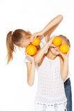 Beauty young girls with fresh oranges. Healthy lifestyle. Happiness. White background Royalty Free Stock Photo