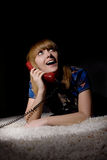 Beauty young happy woman with red phone Royalty Free Stock Photo