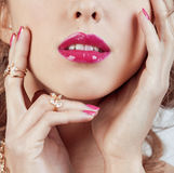 Beauty young luxury woman with jewellery, rings, nails close up on white Royalty Free Stock Images