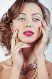Beauty young luxury woman with jewellery, rings, nails close up on white Royalty Free Stock Image