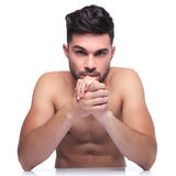 Beauty young man holding his palms together Stock Photos