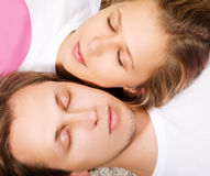 Beauty young man and woman in a dream. Lie in a studio Stock Photos