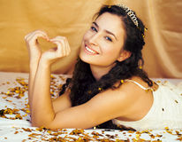 Beauty young princess with gold confetti and tiara Stock Photos