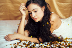 Beauty young princess with gold confetti and tiara Stock Photo