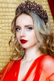 Beauty young queen long blond hair crown on her head close up and red lips Royalty Free Stock Image