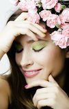 Beauty young real woman with pink flowers and make Stock Photos