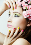 Beauty young real woman with pink flowers and make Royalty Free Stock Photography