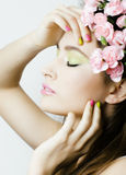 Beauty young real woman with pink flowers and make up closeup, spa salon Royalty Free Stock Photo