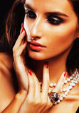 Beauty young sencual woman with jewellery close up, luxury portrait of rich real girl. Party makeup Royalty Free Stock Photography