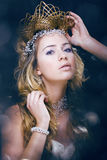 Beauty young snow queen in fairy flashes Stock Photo