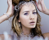 Beauty young snow queen in fairy flashes Stock Images