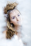 Beauty young snow queen in fairy flashes Royalty Free Stock Images