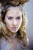 Beauty young snow queen in fairy flashes Royalty Free Stock Photo