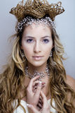 Beauty young snow queen in fairy flashes Royalty Free Stock Image