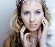 Beauty young snow queen in fairy flashes with hair Royalty Free Stock Images