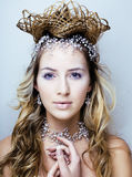 Beauty young snow queen in fairy flashes with hair crown on her head Stock Photography