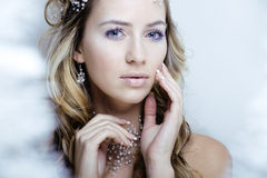 Beauty young snow queen in fairy flashes with hair Royalty Free Stock Photography