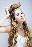 Beauty young snow queen with hair crown on her head, complicate Stock Photos