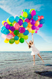 Beauty young stylish woman with multi-colored rainbow balloons i stock image