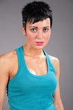 Beauty young sweaty woman in blue t-shirt Royalty Free Stock Images