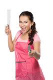 Beauty young wife in action. Beauty young wife hold knife and exasperation Royalty Free Stock Photo