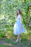 Beauty young woman in the apple garden Royalty Free Stock Photography