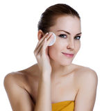 Beauty young woman applying face foundation Stock Photos
