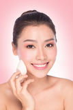 Beauty young woman applying face foundation Royalty Free Stock Photo