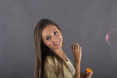 A beauty young woman blowing soap bubbles Royalty Free Stock Photography
