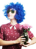 Beauty young woman in a blue wig with flowers Stock Images