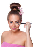 Beauty young woman brushing concealer under eyes Royalty Free Stock Image