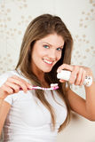 Beauty young woman brushing her teeth. In white Royalty Free Stock Photography
