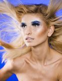 Beauty young woman with creative make up, flying Royalty Free Stock Images