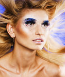 Beauty young woman with creative make up, flying hair Stock Photos