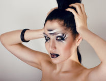 Beauty young woman with creative make up like zebra Royalty Free Stock Photo