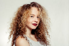 Beauty young woman with curly big and long hair. People, youth and beauty concept - Beauty young woman with curly big and long hair. Permed hair. Glamour lady Stock Photo