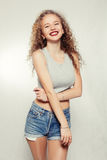 Beauty young woman with curly big and long hair. People, youth and beauty concept - Beauty young woman with curly big and long hair. Permed hair. Glamour lady Royalty Free Stock Photo