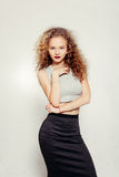 Beauty young woman with curly big and long hair. Royalty Free Stock Photos