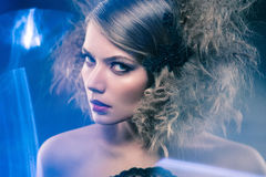 Beauty young woman with curly big and long permed hair. Beauty young woman with curly big and long hair. Permed hair. Glamour lady, Beauty Girl on blue Stock Image