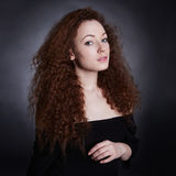 Beauty young woman with curly hair Stock Photo