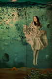 Beauty young woman in dress under water, vintage, Stock Photography