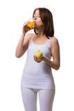 Beauty young woman drinks apple juice from glass a Stock Photography