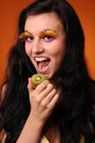 Beauty young woman eat kiwi Stock Photography