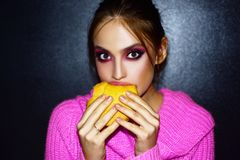 Beauty young woman. face. Advertisement, magazine. Attractive girl eating hamburger. royalty free stock photography