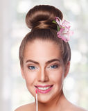 Beauty young woman face with lipgloss Royalty Free Stock Photo