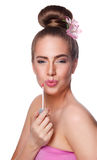 Beauty young woman face with lipgloss Royalty Free Stock Photography