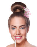 Beauty young woman face with lipgloss Stock Photography